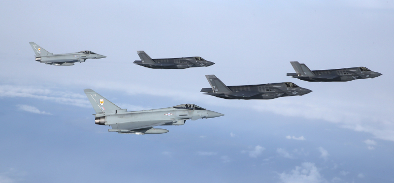 F35 Lightning arrives into the UK, Flanked by 2, 1Sqn Typhoons and photographed by a 100 Sqn Hawk. The first of Britain's new supersonic 'stealth' strike fighters has touched down in the UK for the first time. The F-35B Lightning II jet was flown by RAF pilot Squadron Leader Hugh Nichols on its first transatlantic crossing, accompanied by two United States Marine Corps F-35B aircraft from their training base at Beaufort, South Carolina. The combined US/UK team of aircrew and engineers are here in the UK to demonstrate just what the 5th generation state of the art aircraft can do, flying at the Royal International Air Tattoo and Farnborough International Air Show over the next few weeks. The aircraft are due to enter service with the Royal Navy and RAF from 2018.